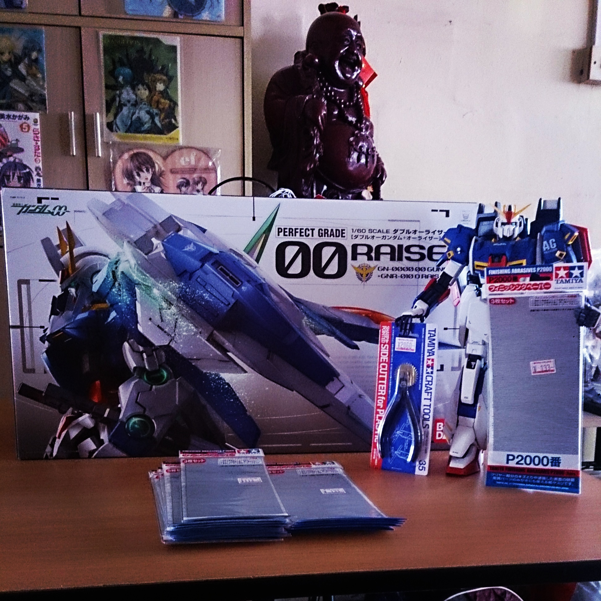 1/60 scale PG 00 awaiting assembly, standing by is the PG Zeta with the appropriate tools.