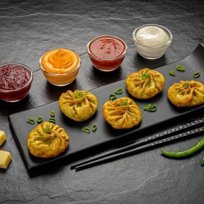 Veg Fried Chilli Cheese Momos image
