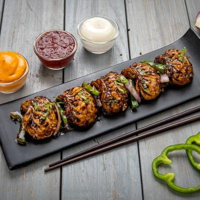 Chicken Momos In Manchurian Sauce image