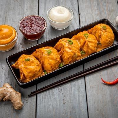 Chicken Momos In Tandoori Mayo Sauce image