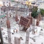 Proyek pembangunan revitalisasi rusun menjadi apartemen komersil, di Sentraland Sukaramai, kawasan Asia Mega Mas.