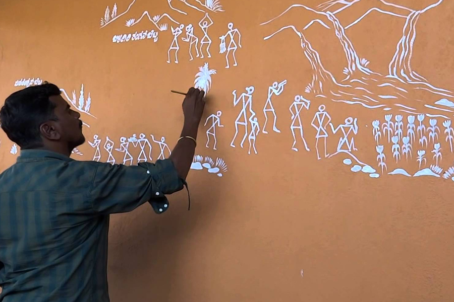 Man painting Warli