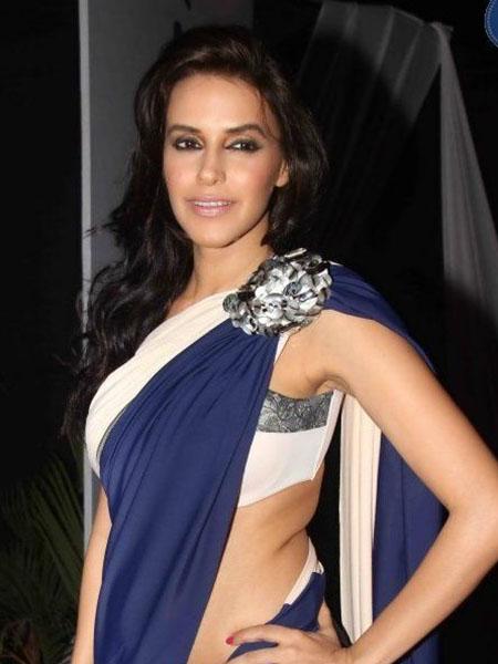 Neha Dhupia wearing a brooch