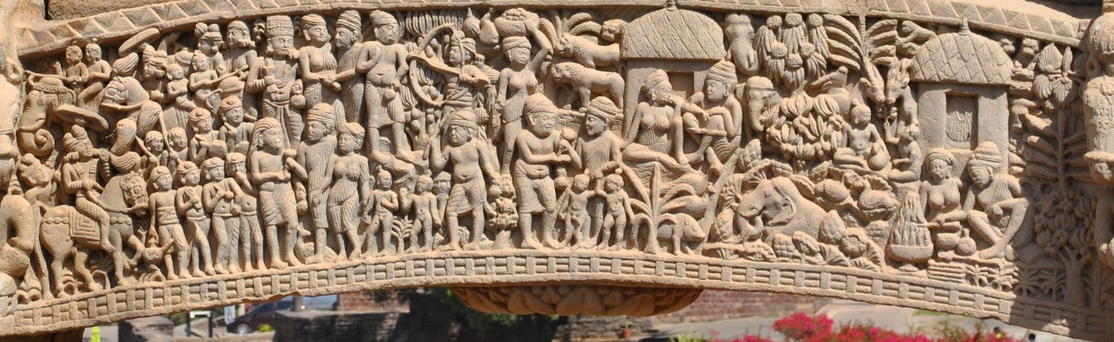 Northern Gateway - Jataka tale of Vasantara reiterating importance of sacrifice. From left Vasantara is shown leaving palace with children, then staying in a hermit after giving away both his children