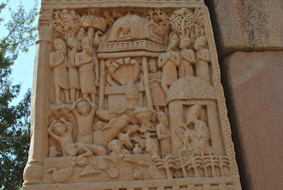 Eastern gateway - On left, the Kashyapa brothers warning buddha about 5 headed cobra