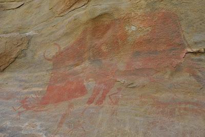 Bhimbetka Rock Shelter 15 - Mythical large size boar chasing scrawny human.