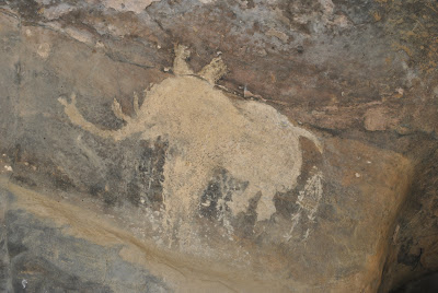 Bhimbetka Rock Shelter 9 - Elephant followed by shrouded man.