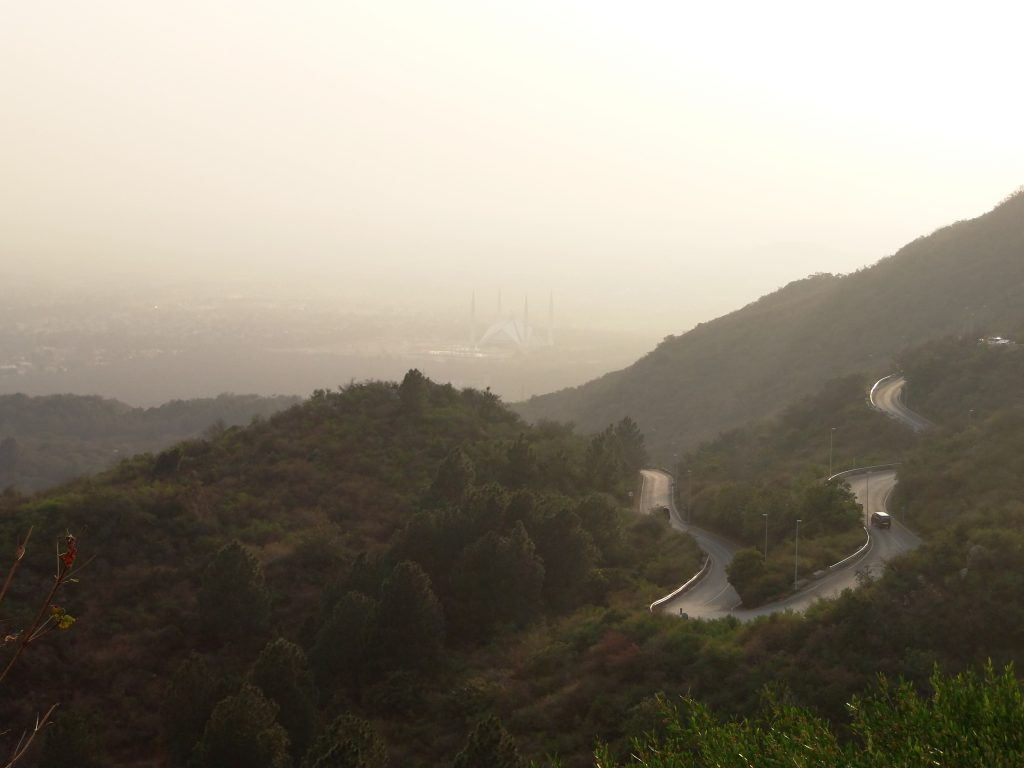 View of Faisal Mosque hidden behind the smog. And the road leading to Daman-e-Koh. Photo by the author.