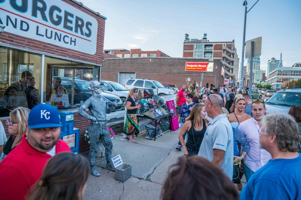 Artists and performers line up during First Friday's at the Crossroads