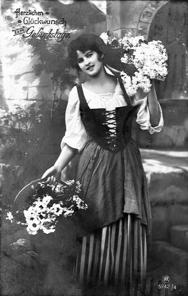 A postcard from 1918 showing a woman in Dirndl. Modern designs tend to have shorter skirts, up to the knee.