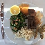 Kebbeh making its way to Sunday's plates along with Taboule, Rice, Fish and bread.