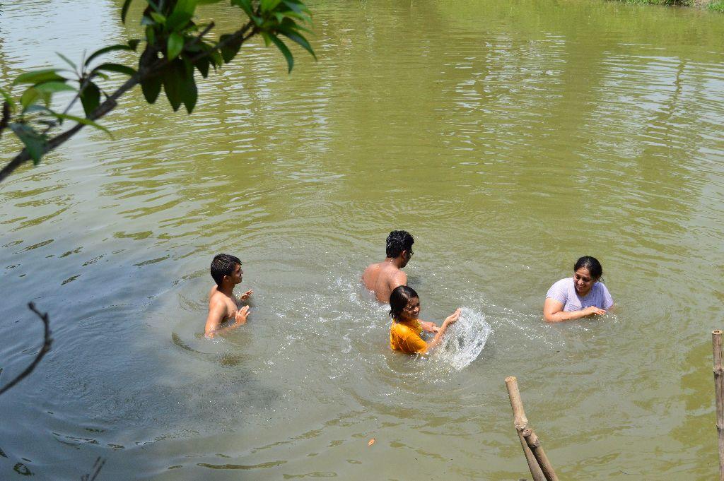 Bathing in the Pukur