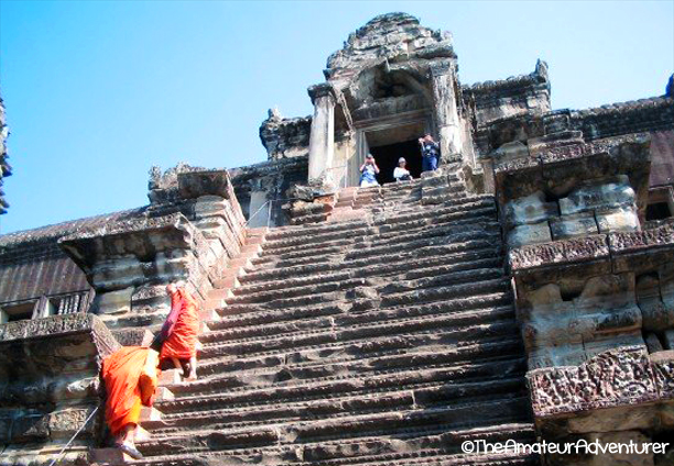 Climbing to the top of the temple at Angkor Wat