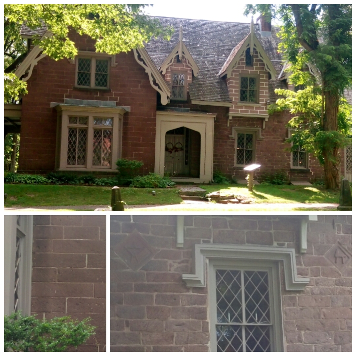 The Gothic revival refers to the Medieval churches of Europe as the house is constructed with diamond windows, columns, peaked roofs, arched door entrances, high chimneys. The walls on the left are after the renovation. Thus, the bricks used in them are structured properly. While, the ones on the right, are the ones constructed by secret society as it has masonic symbols, building tools in particular, like the hammer and others, constructed over the bricks.