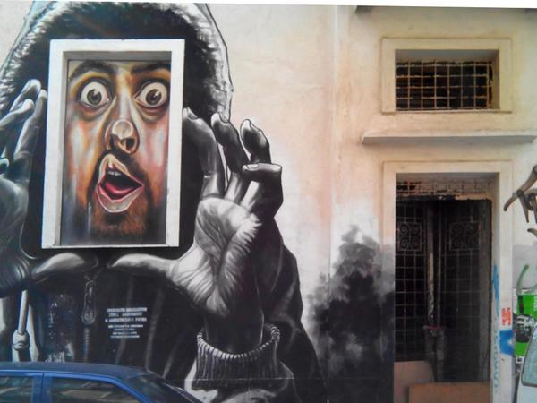 Exarcheia_area,_Street_artwork_by_the_artist_WD_(Wild_Drawing)_6-11-2014_Photo_courtesy_Maria_Chatzidakis