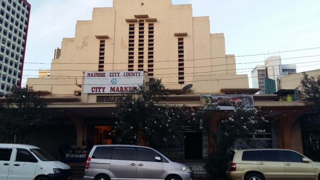 The Entrance to Nairobi City Market showing the towering light brown building