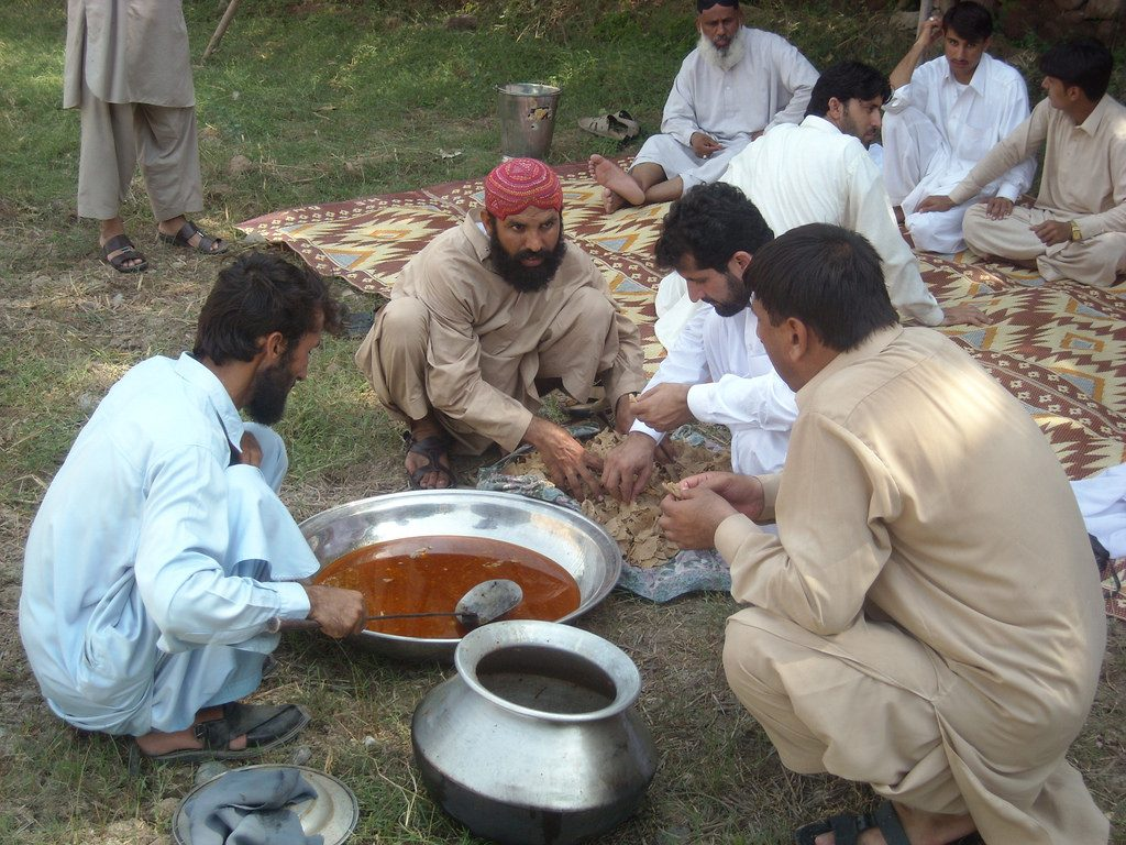 Men enjoying a traditional meal of Sohbat. Photo credit: Drabankalan/Flickr
