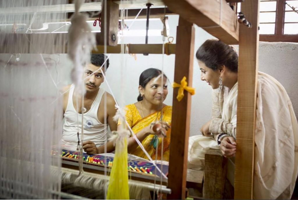 Actor Vidya Balan interacts with workers at the handlooms.