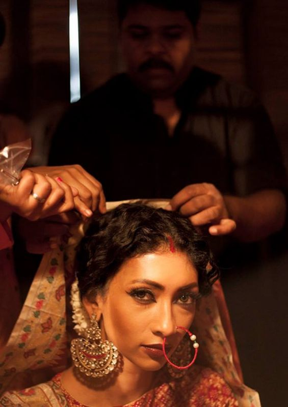 Gaurang preps a model before a fashion show.