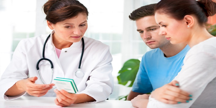 Doctor consults a young couple