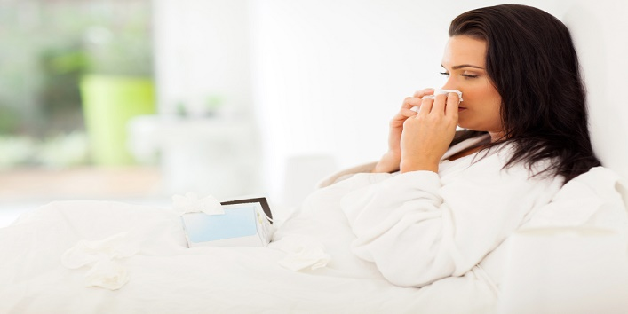 sick woman in bed