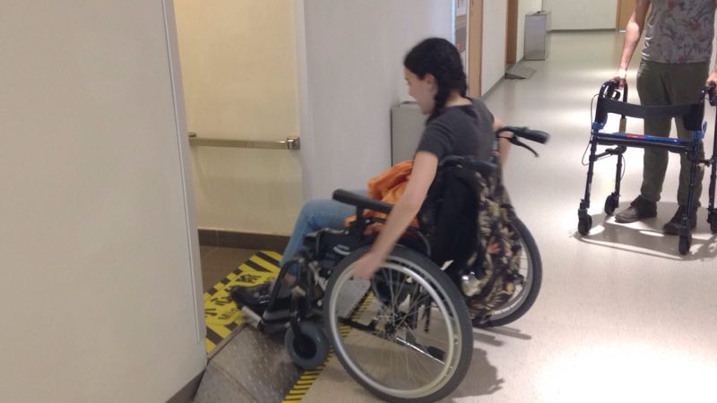 Wheelchair approaches steep ramp and cannot pass