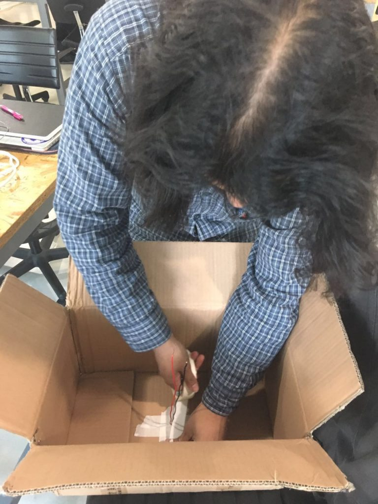 installing the push button onto the base of the box. This would activate each video.