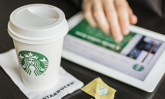 Starbucks cup and laptop to show Starbucks is now sponsoring education of its employees