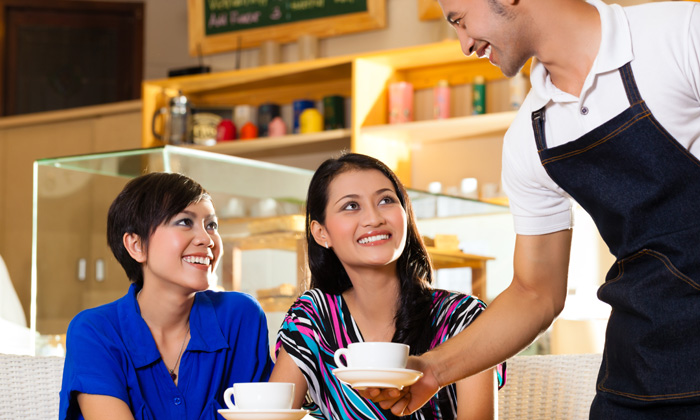 Waiter serving coffee for article on ex-offenders being hiring by F&B bosses in Singapore