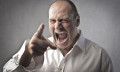 Man angry pointing and yelling to get what he wants