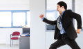 man running through office