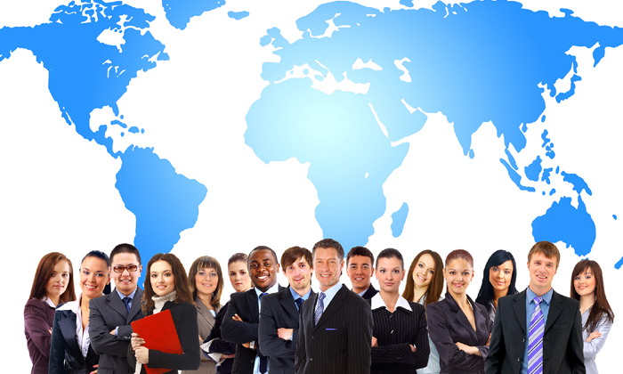 Businesspeople standing in front of map to show countries which attract the most talent