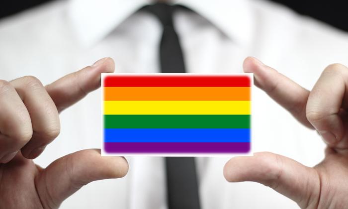 Employee holding LGBT flag