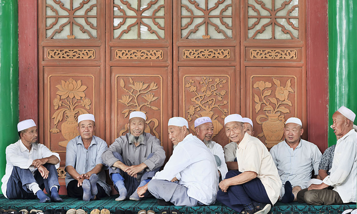 Chinese Muslim men in front of mosque