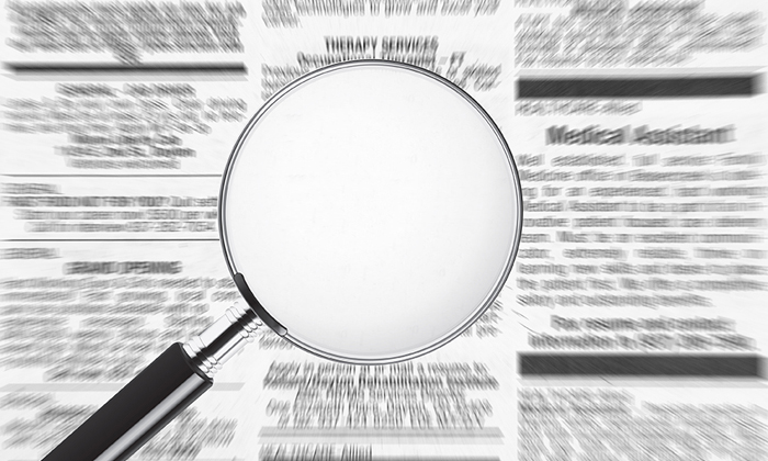 Magnifying glass over job ads