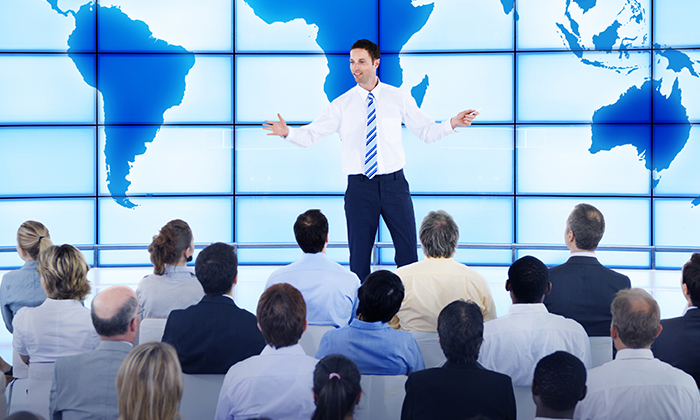 Man speaking in front of public conference to show people dimension of MICE events