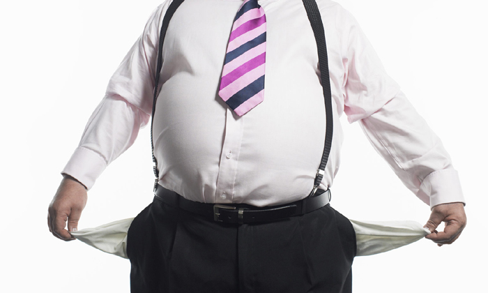 Fat businessman with pockets out to show he's poor