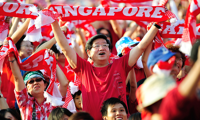 Man celebrating Singapore's National Day