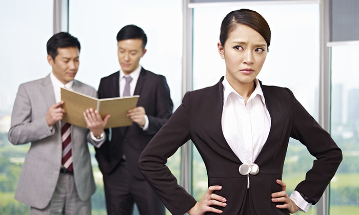 Asian businesswoman being discriminated against at work