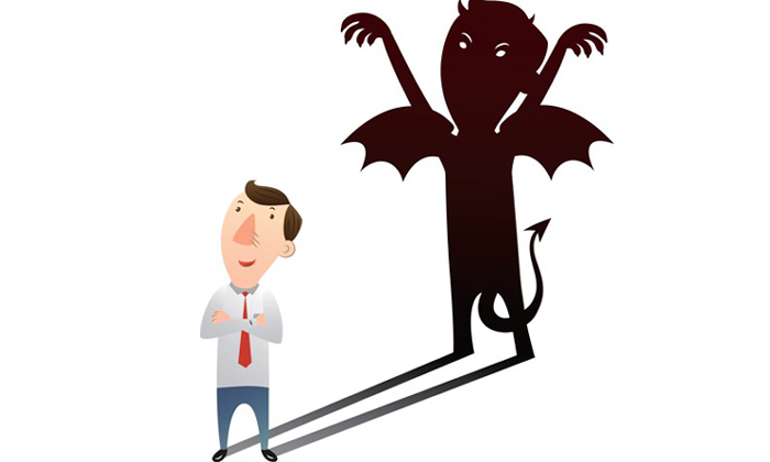 Evil shadow emerging out of businessman to show millennials lie at work to get ahead