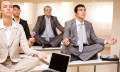 Employees meditating to show jobs with the best work-life balance