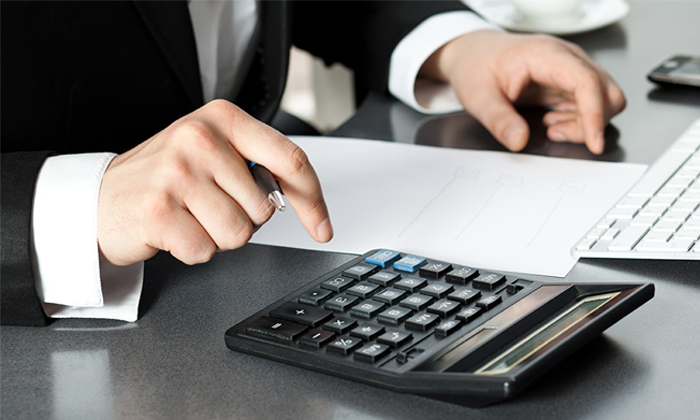 Businessman on calculator