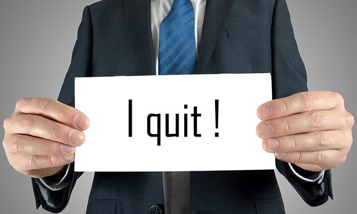 Quit sign by businessman
