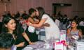 Nalaini Arumugam hugged by her colleague at Astro at ARA MY
