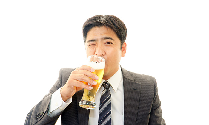 Businessman enjoying a beer