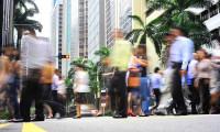 PMETs walking through Singapore's bustling CBD