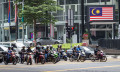 Bikers commuting on the busy streets of Kuala Lumpur