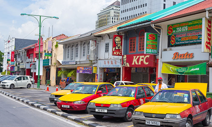 A row of Malaysian taxis parked