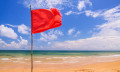 Red flag on a beach, hr