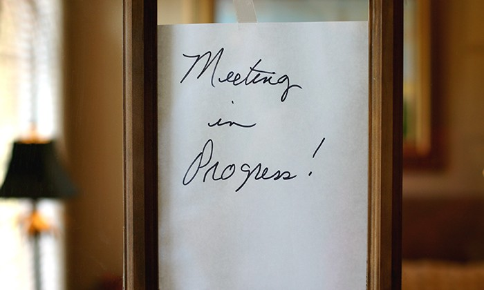 Note on meeting room door, hr